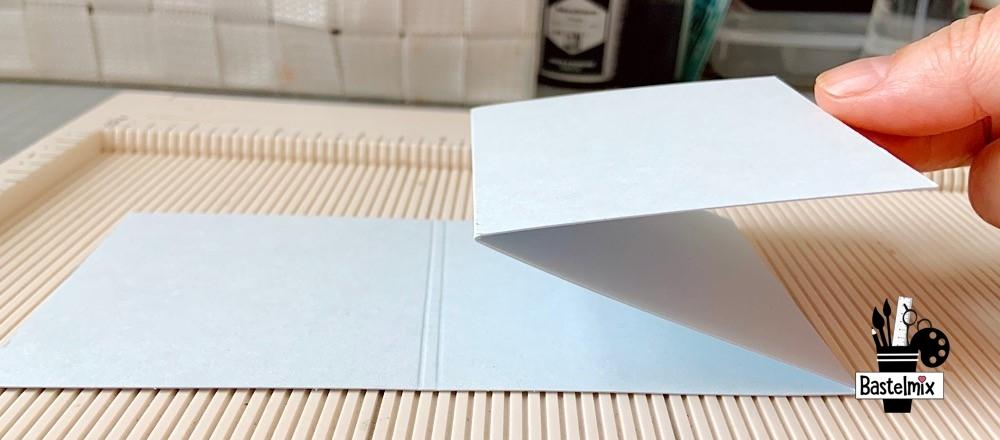 Papier falten auf Falzbrett